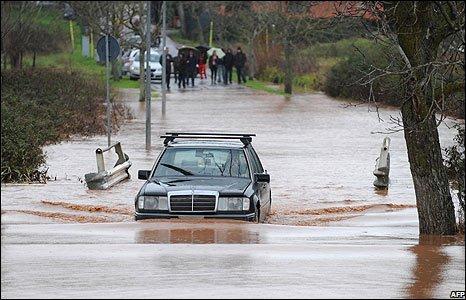 A car on a flooded street in Trigoria near Rome, Italy