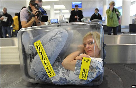 An activist in a plastic suitcase at Munich airport, Germany