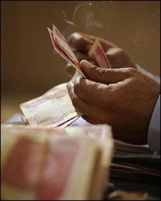 Counting Iraqi money in Baqouba, Iraq