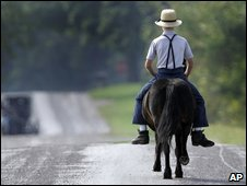 Amish boy on horseback