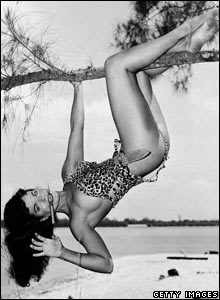 Bettie Page in a Tarzan pose in Africa, 1950s.