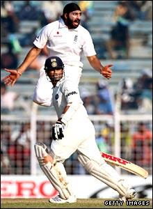 Monty Panesar leaps behind Tendulkar