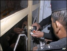 Police seal the door of a Jamaat-ud-Dawa office in Multan, Pakistan
