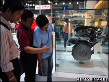 Visitors view an engine developed by BYD Auto at 2008 China High-tech Fair (October 2008) in Shenzhen