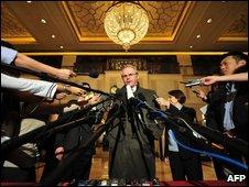 Christopher Hill speaks to reporters in Beijing