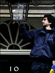 Fitting an energy efficient bulb at Downing Street (Image: PA)