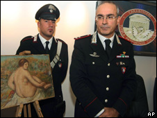 Italian Carabinieri stand beside a painting by Pierre-Auguste Renoir during a press conference in Rome (file photo)