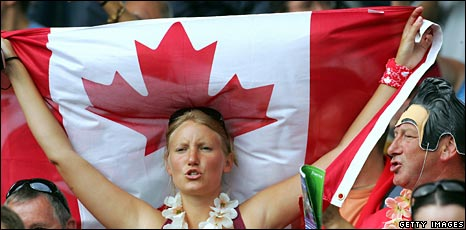 A Canadian with a maple leaf flag