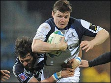 Leinster's Brian O'Driscoll is tackled by Lionel Nallet of Castres