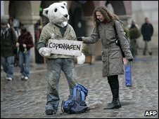Man in polar bear costume hitching to Copenhagen