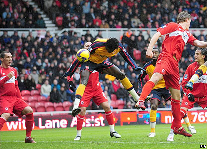 Arsenal's Emmanuel Adebayor heads Arsenal ahead