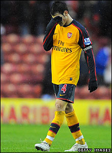Arsenal captain Cesc Fabregas shows his frustration at the final whistle