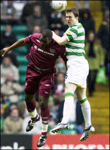 Hearts' Christian Nade (left) loses out in the air to Gary Caldwell