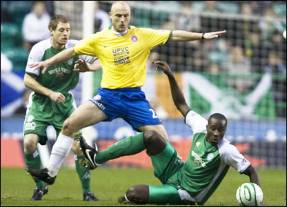 Hamilton's Simon Mensing (centre) is squeezed out by Hibs pairing Sol Bamba and David Van Zanten (left)