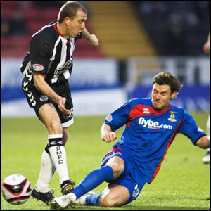 Andrew Barrowman (right) puts in a terrific sliding challenge on Saint Mirren's Garry Brady