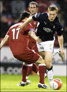 Scott Arfield skips past Aberdeen's Dee Visscher (left)
