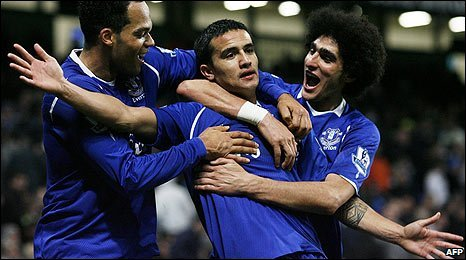 Tim Cahill (centre) is mobbed by his Everton team-mates