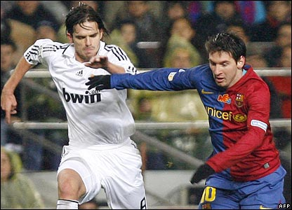 Lionel Messi fights for the ball with Real Madrid's Fernando Gago