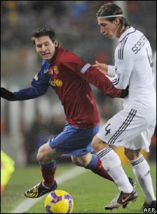 Lionel Messi with Madrid defender Sergio Ramos