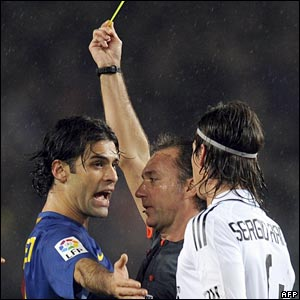 Barcelona's Rafael Marquez protests after being booked