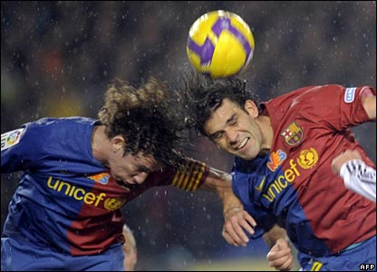 Barcelona's Carlos Puyol and Rafael Marquez battle for a header