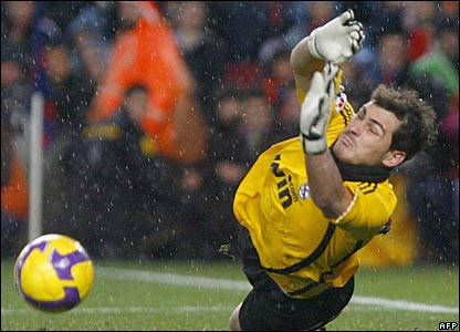Iker Casillas dives to save a shot