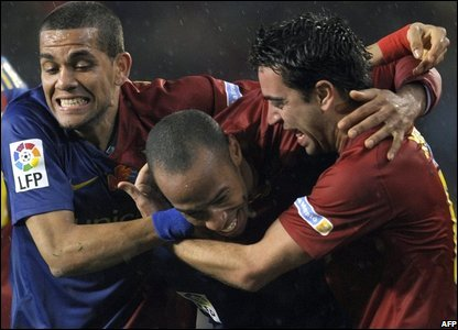 Barcelona's Dani Alves, Thierry Henry and Xavi celebrate