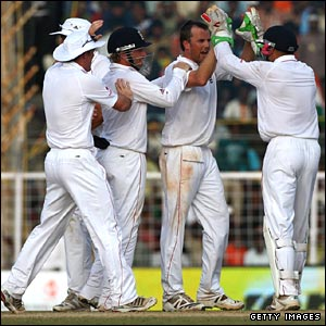 England celebrate Sehwag's wicket