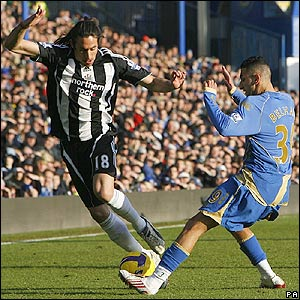 Pompey's Nadir Belhadj attempts to tackle Jonas Gutierrez