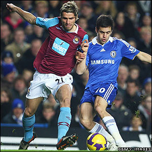 Behrami and Cole contest possession at Stamford Bridge