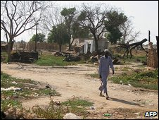 Man walks in Abyei street, November 2008