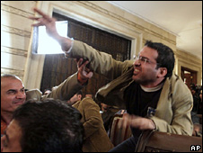 Muntadar al-Zaidi throws a shoe at George Bush (14 December 2008)