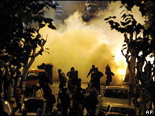 Protesters run away from police tear gas (13 December 2008)