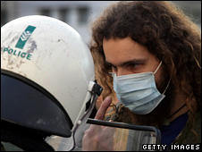 Greek protester faces off against a riot policeman