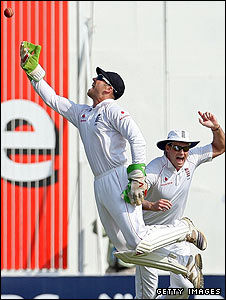 England keeper Matt Prior tosses the ball high after taking the catch as Dravid fails for the second time in the match