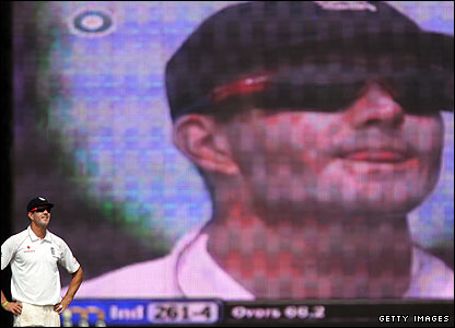 England skipper Kevin Pietersen is dwarfed by his image on the giant screen as he tries to conjure up a wicket for his side