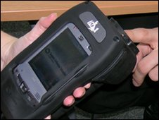 Mobile electronic fingerprint device (Pic: Greater Manchester Police)