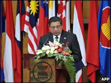 Indonesian President Yudhoyono applauds the charter among Asean's ten flags