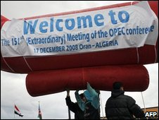 Algerian workers prepare an inflatable welcome banner