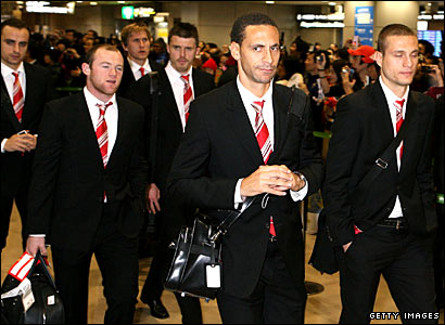 Manchester United players arrive at Tokyo's Narita International Airport