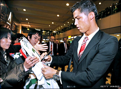 Cristiano Ronaldo signs autographs for fans