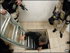 Police investigate a tunnel under the US-Mexican border in a file photo from 2006