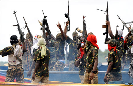 Movement for the Emancipation of the Niger Delta (Mend) fighters in Nigeria raise their riffles to celebrate news of a successful operation (Photo: Pius Utomi Ekpei/AFP - 17 September 2008)