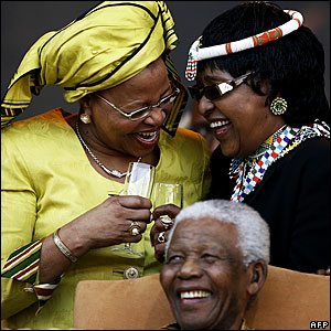 Nelson Mandela at an event at the Loftus Versfeld Stadium in Pretoria to celebrate his birthday with his wife Graca Machel (l) and his ex-wife, Winnie Madikizela-Mandela. (Photo: Michelly Rall/AFP)