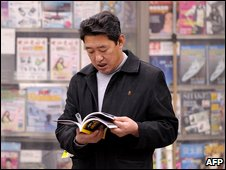 Man at magazine stand in Beijing