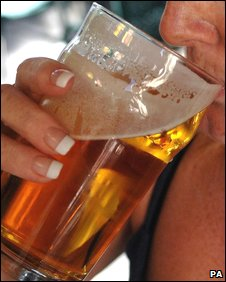 File pic of woman drinking beer