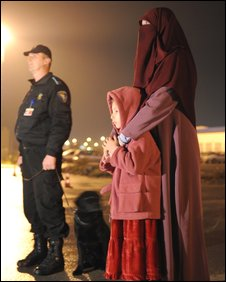 Mr Boudella's wife and daughter await his arrival at Sarajevo airport