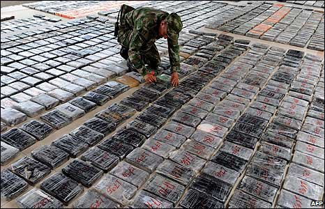 A soldier with seized bags of cocaine in Uruba, Colombia