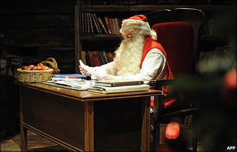 Father Christmas at work in his office in Rovaniemi, Lapland