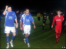 Chesterfield's Jack Lester (centre) and Gregor Robertson (left) leave the pitch after floodlight failure